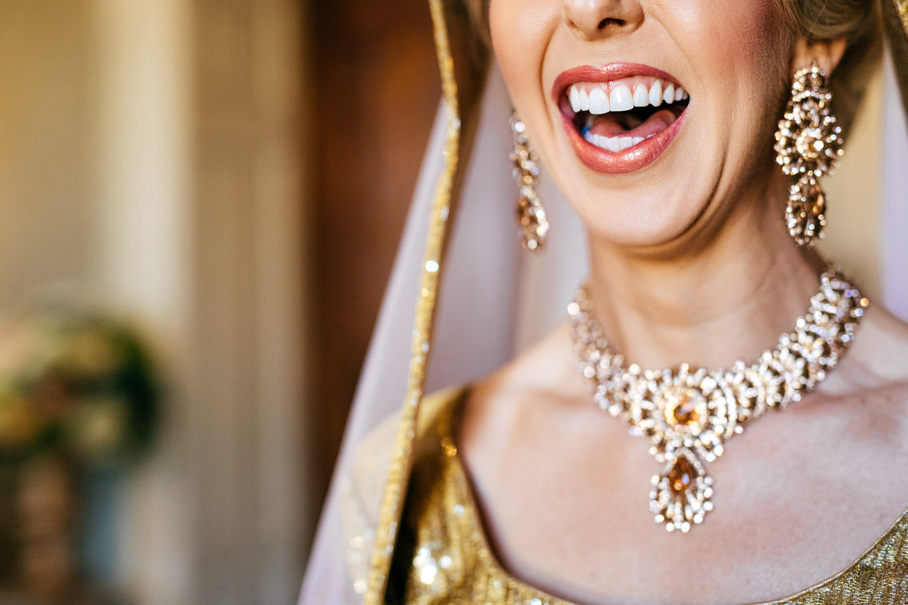 Close up of smiling bride at Hedsor House Indian Wedding