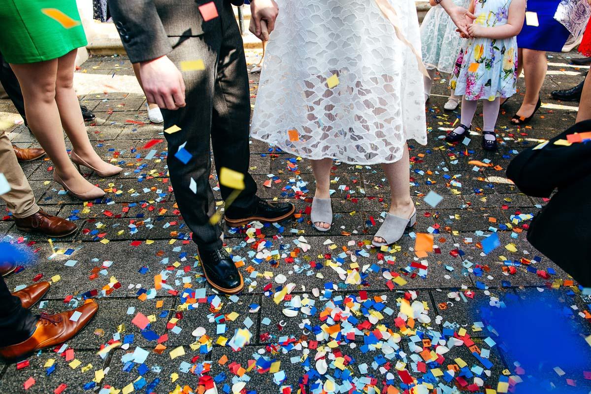 Colourful confetti London Wedding Photographer confetti on floor