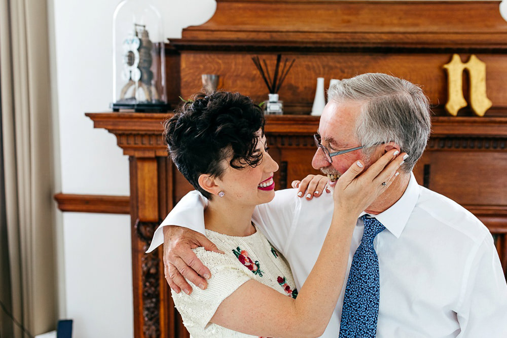 bride-and-father-embrace-tamara-gomez-engagement-ring