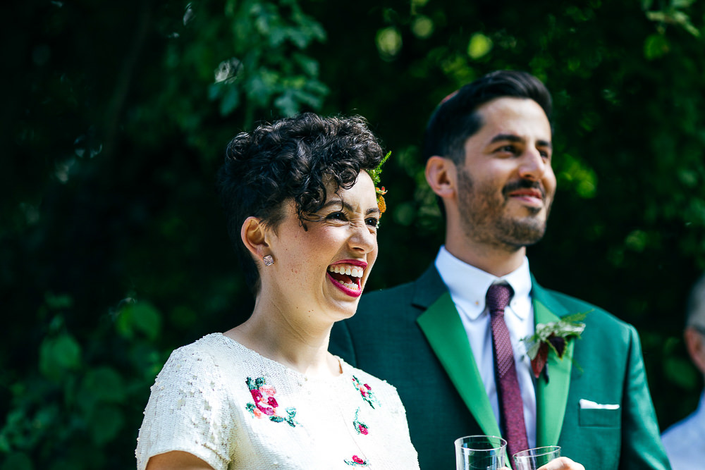 short-haired-bride-laughing-during-ceremony-jewish-wedding-jordanna-marston-photography