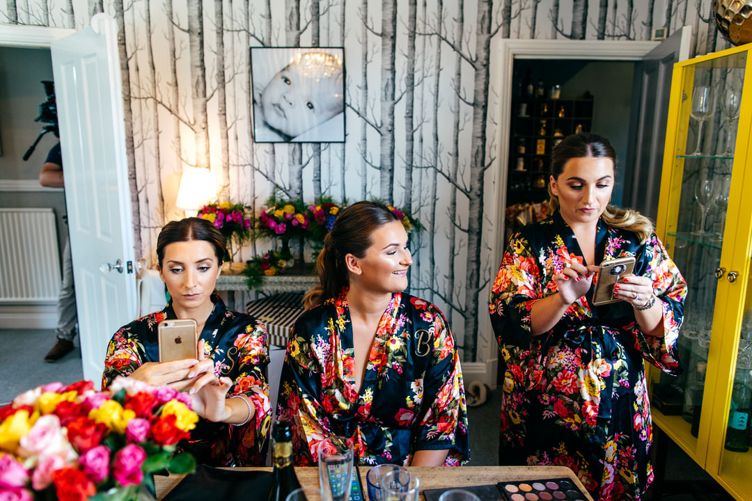 Bridesmaids getting ready in matching dressing gowns