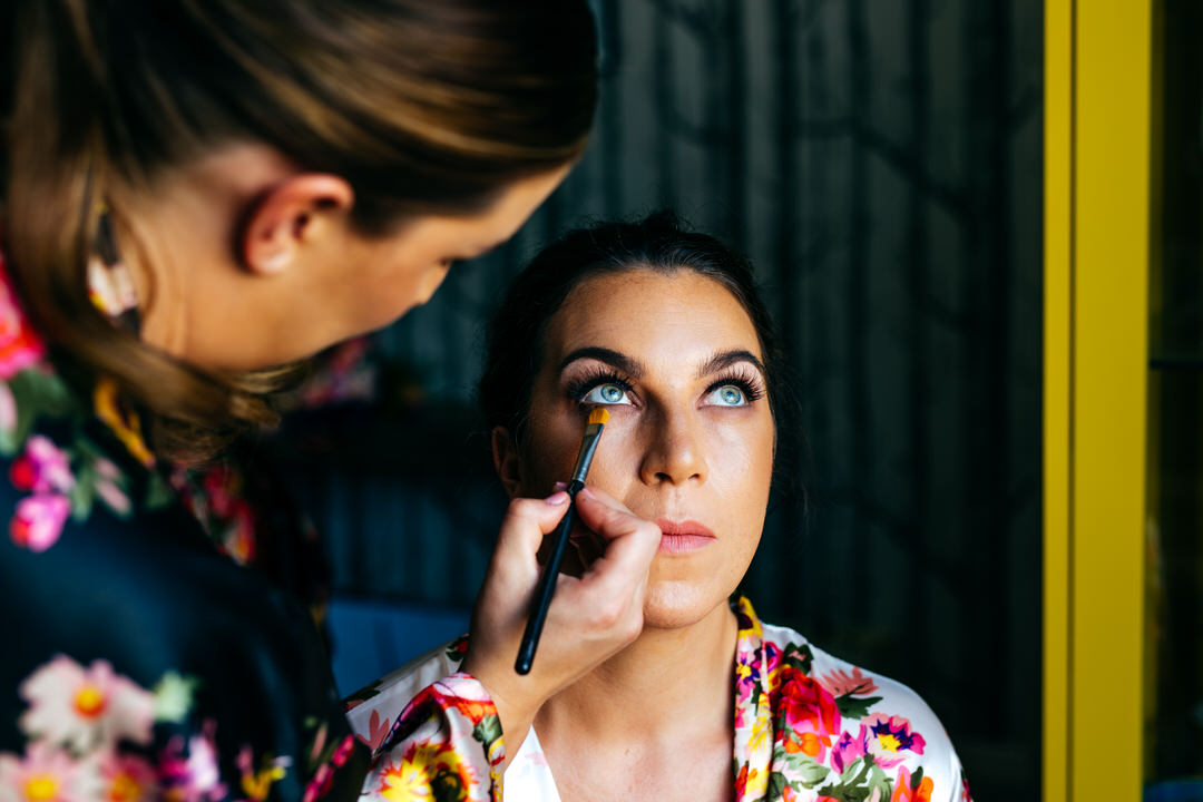 Bride has eye make up applied during bridal prep before Twelve Restaurant Wedding