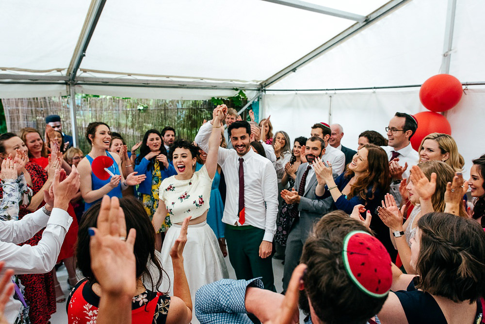 bride-wearing-bhldn-celebrates-with-guests-and-groom-london-wedding-photographer