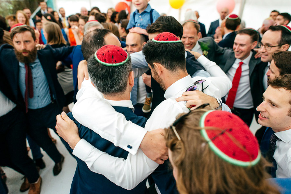 groom-dances-hora-in-watermelon-kippot