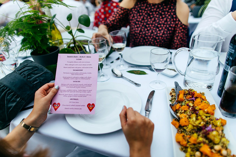 honey-and-thyme-catering-buffett-food-at-wedding-malarko-menu-held-by-guest
