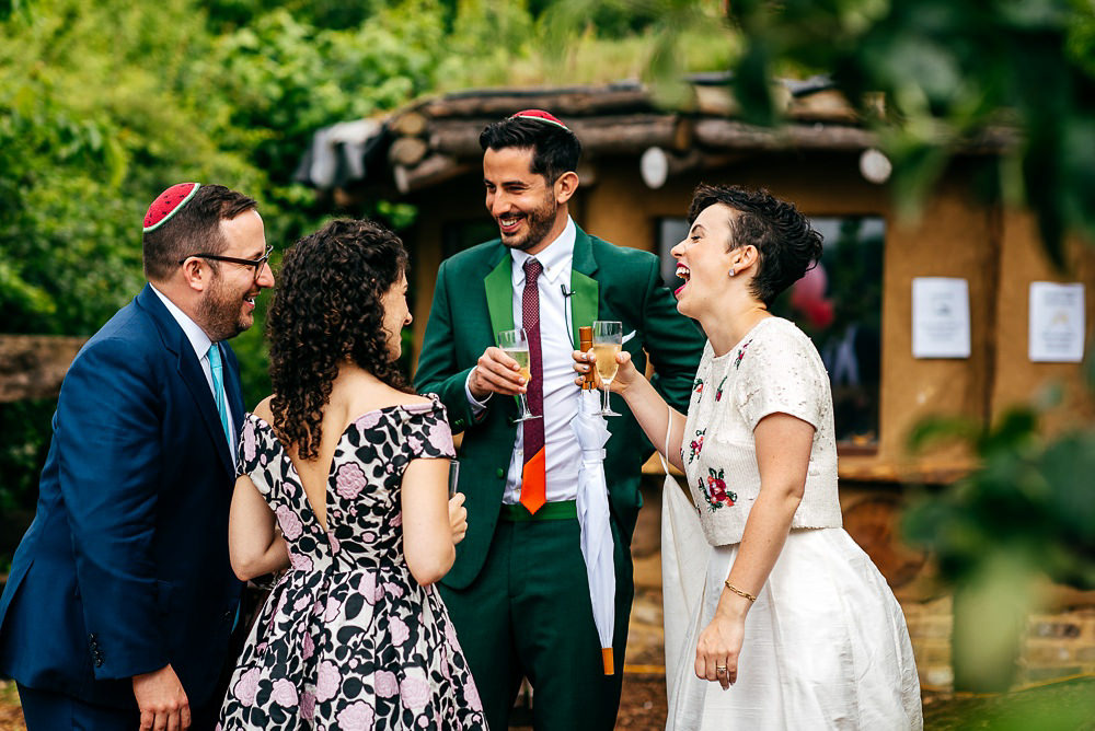 bhldn-bride-paul-smith-groom-laugh-with-guests