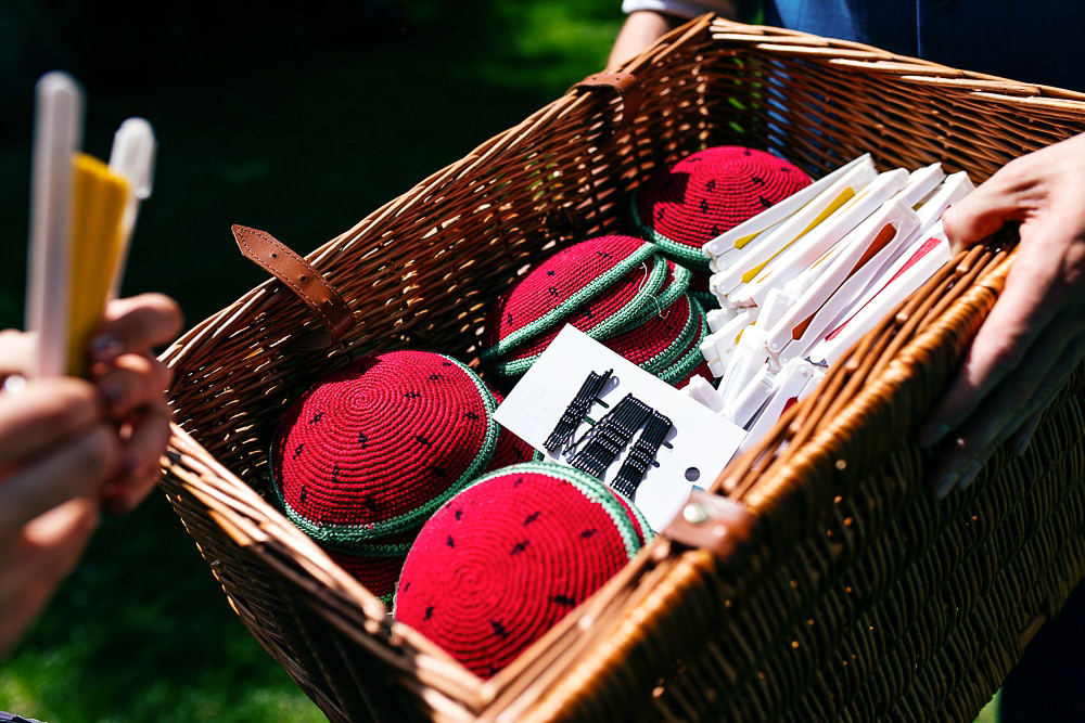 wicker-basket-full-of-fans-for-outdoors-wedding-jordanna-marston-photography