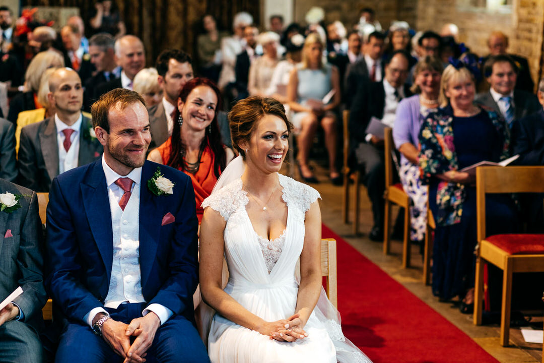 Bride and groom looking very happy during church service in Old.