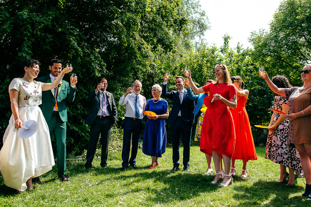 wedding-party-raise-glasses-toast-woodberry-wetlands-centre-wedding