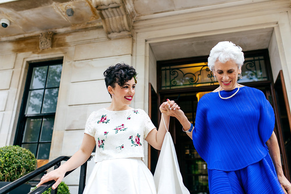 mother-of-bride-blue-outfit-holding-brides-hand-jordanna-marston-photography