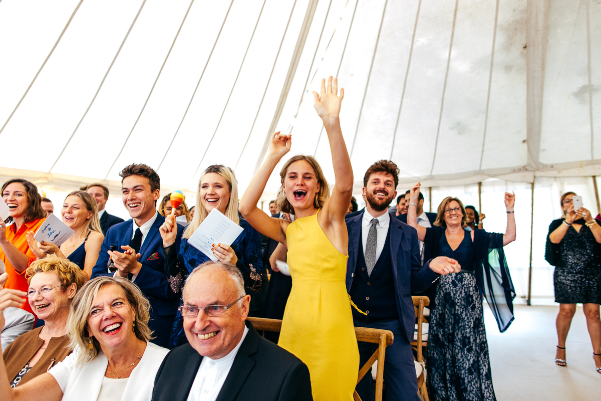 marquee-wedding-trendiy-guests-celebrate-yellow-dress-jordanna-marston-photography