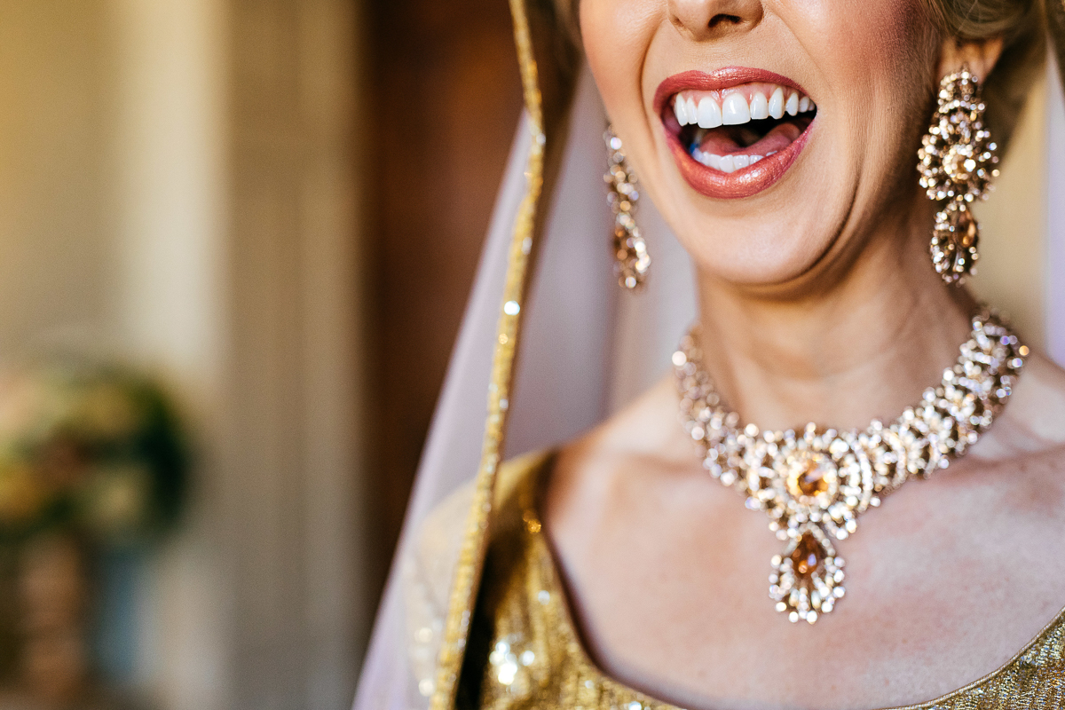 beautiful-laughing-bride-wearing-asian-wedding-attire-creative-wedding-photography