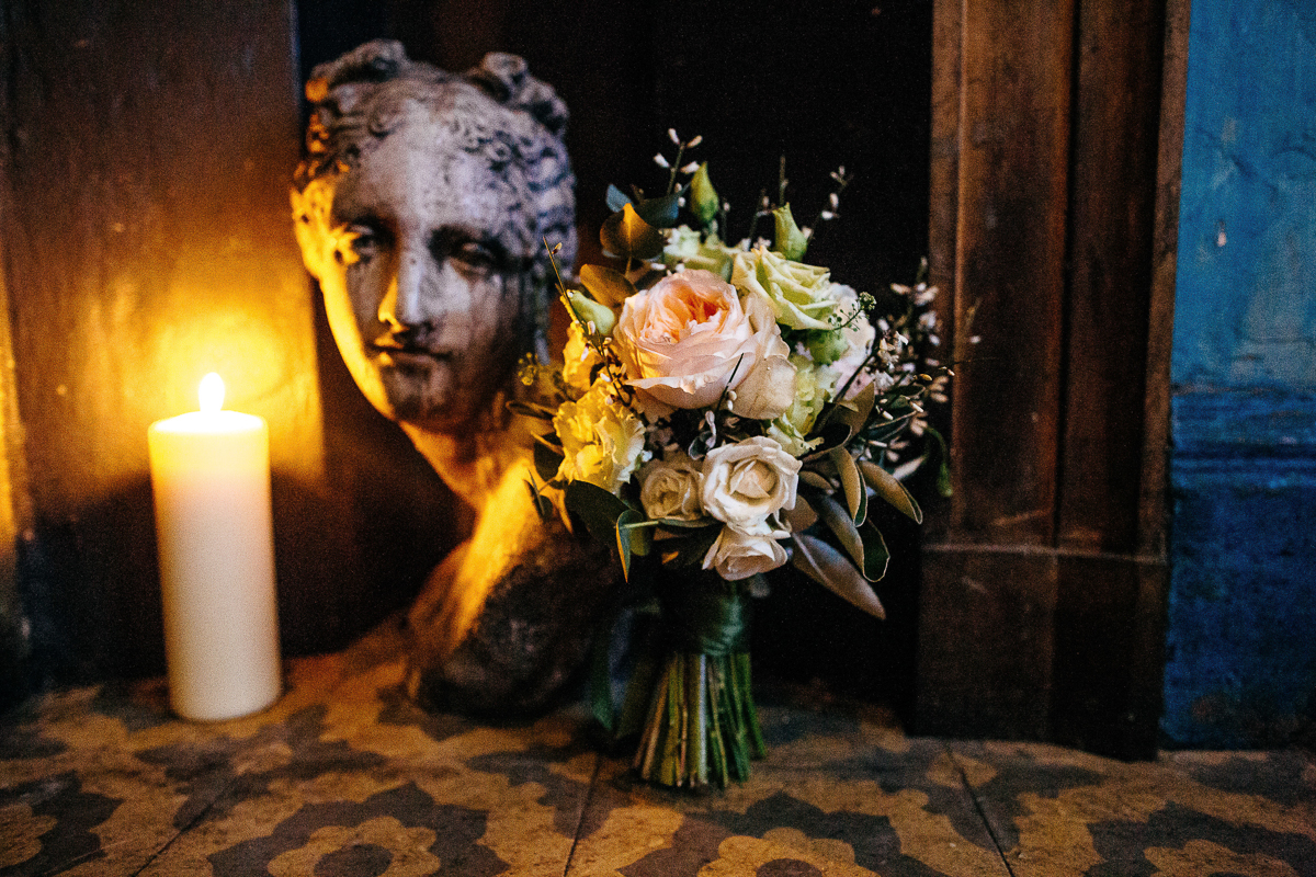 roses-eucalyptus-bouquet-next-to-antique-bust-by-candlelight
