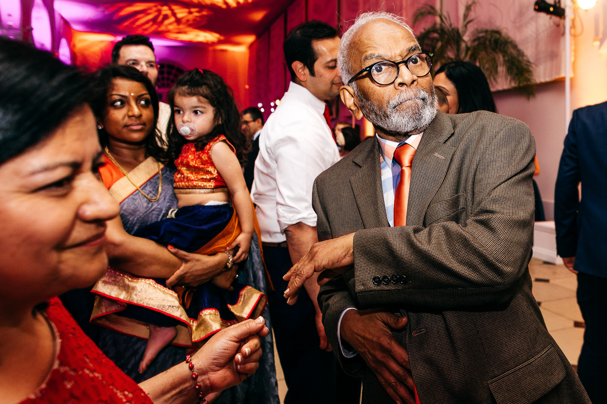 colourful-asian-wedding-party-grandad-dancing