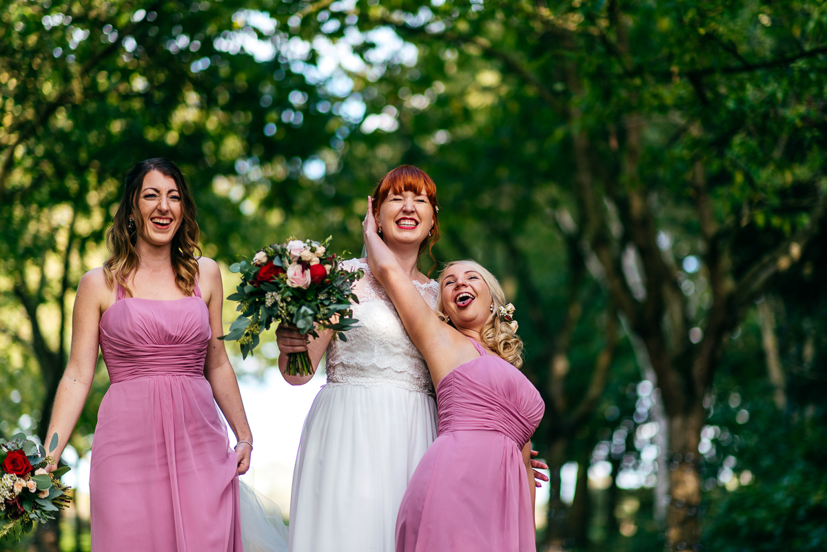 red-haired-bride-poses-for-silly-photos-with-bridesmaids