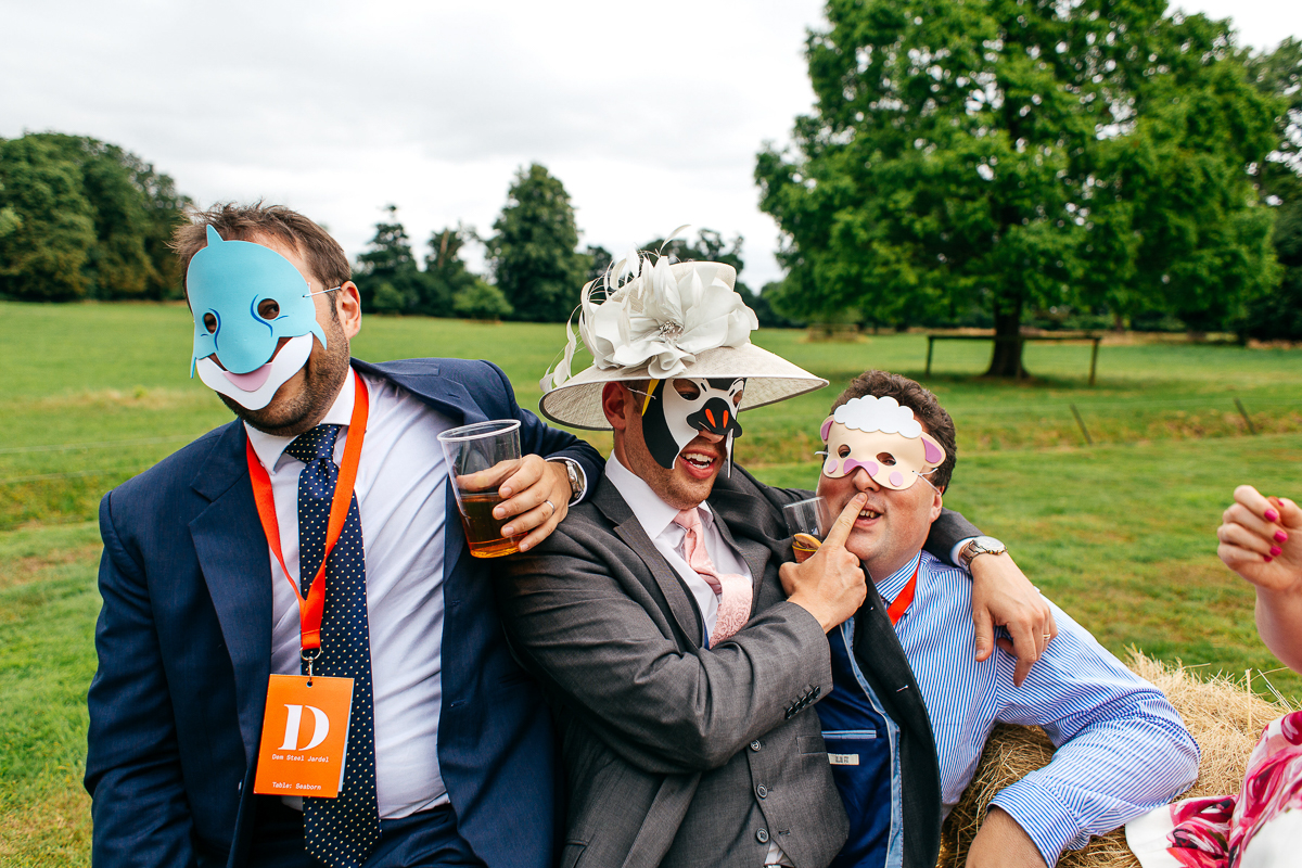funny-guests-wearing-animal-masks-creative-london-wedding-photographer