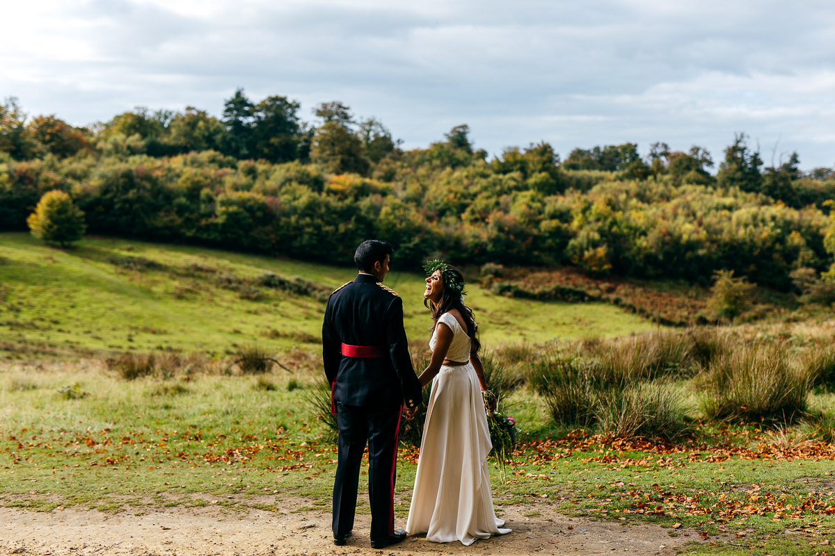 military-wedding-groom-laughs-with-wife-rural-backdrop-creative-wedding-photographer