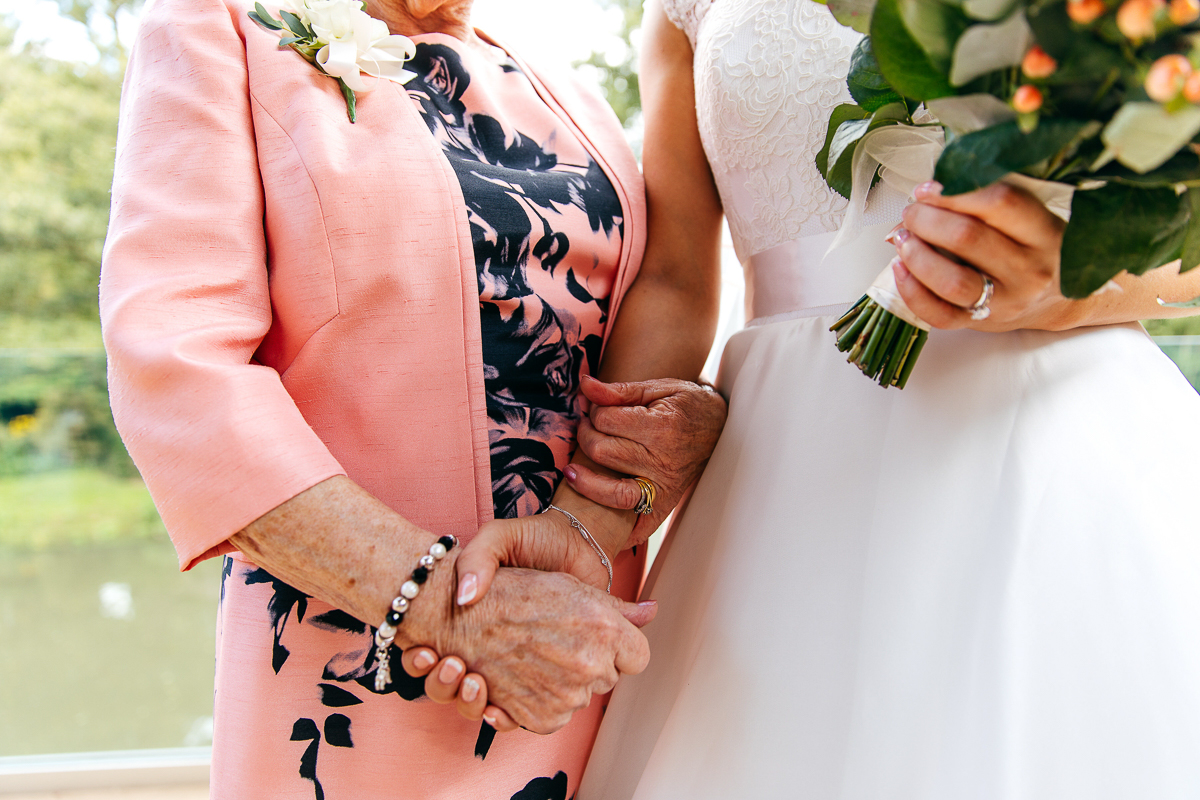 close-up-hands-bride-grandmother-emotive-photo-bride-holding-bouquet