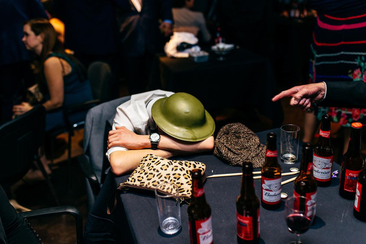 drunk-guest-asleep-wearing-helment-london-wedding-photographer