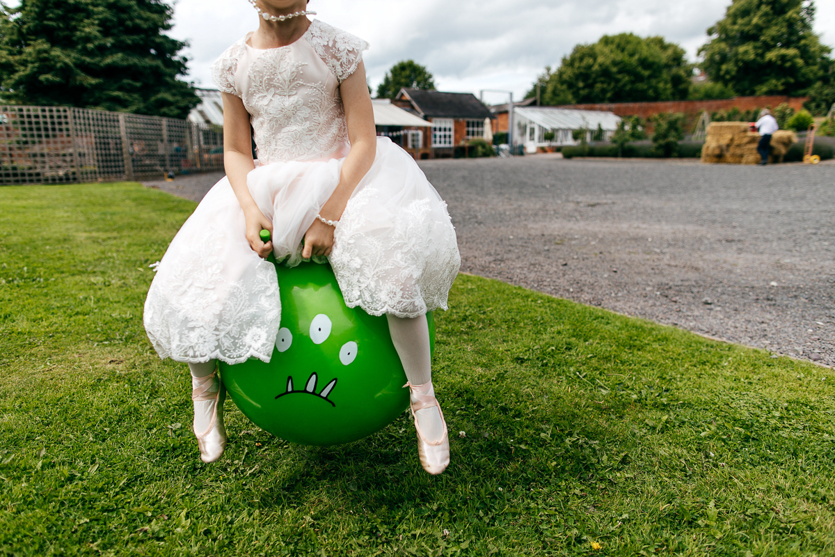 bridesmaid-lace-dress-bounces-spacehopper-creative-wedding-photographer-jordanna-marston