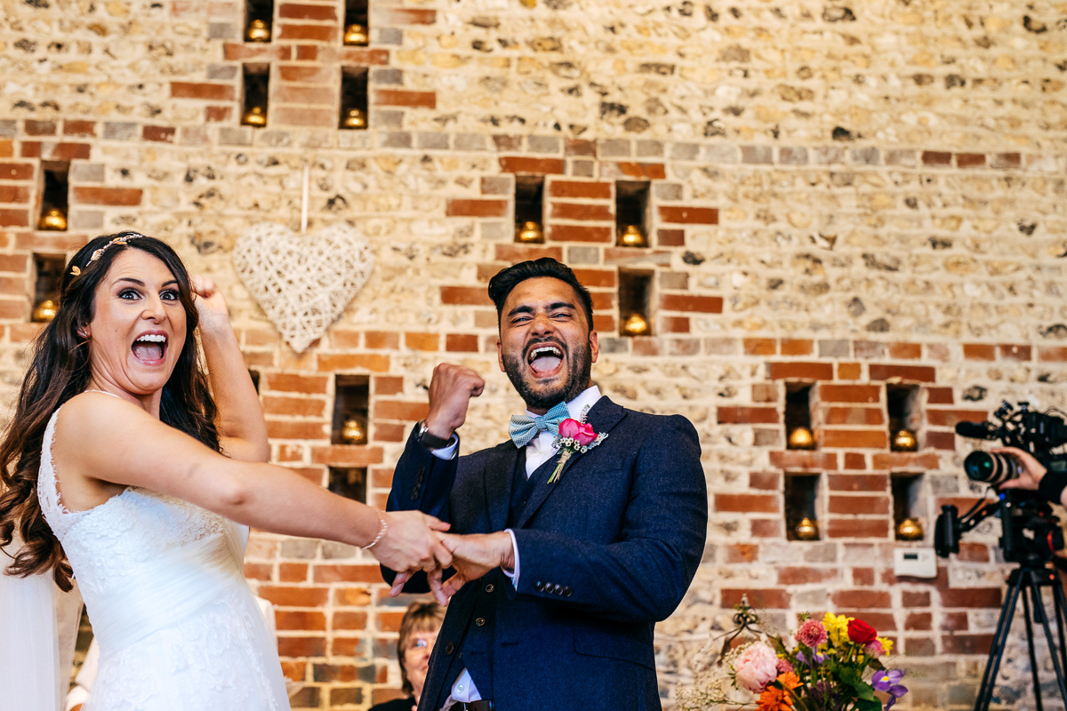 bride-and-groom-fist-pump-barn-wedding-jordanna-martson-photography