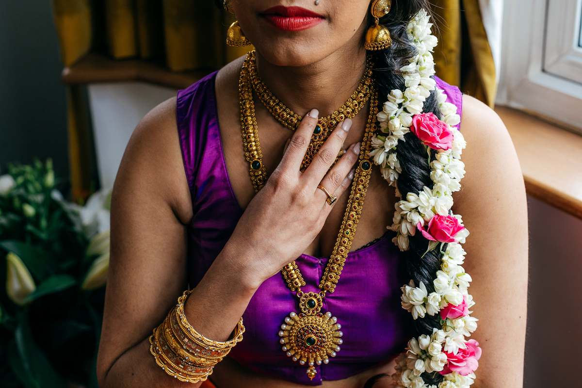 beautiful-asian-bride-flowers-in-hair-holds-necklace-jordanna-marston-photography