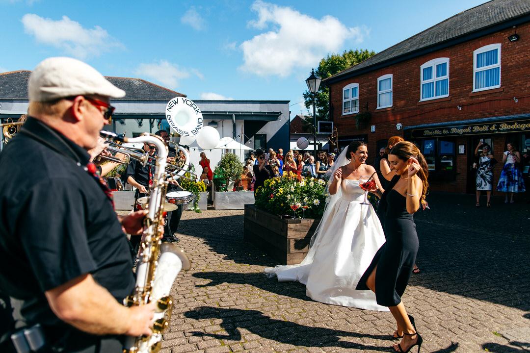 Summer wedding dancing outside Twelve Restaurant to New York Brass Band