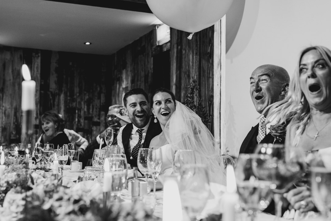 Shocked faces on the top table during best mans speech at Twelve Restaurant Wedding