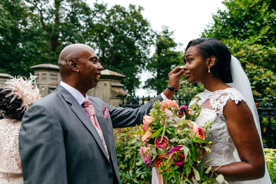 father-of-bride-wipes-away-brides-tear-first-look
