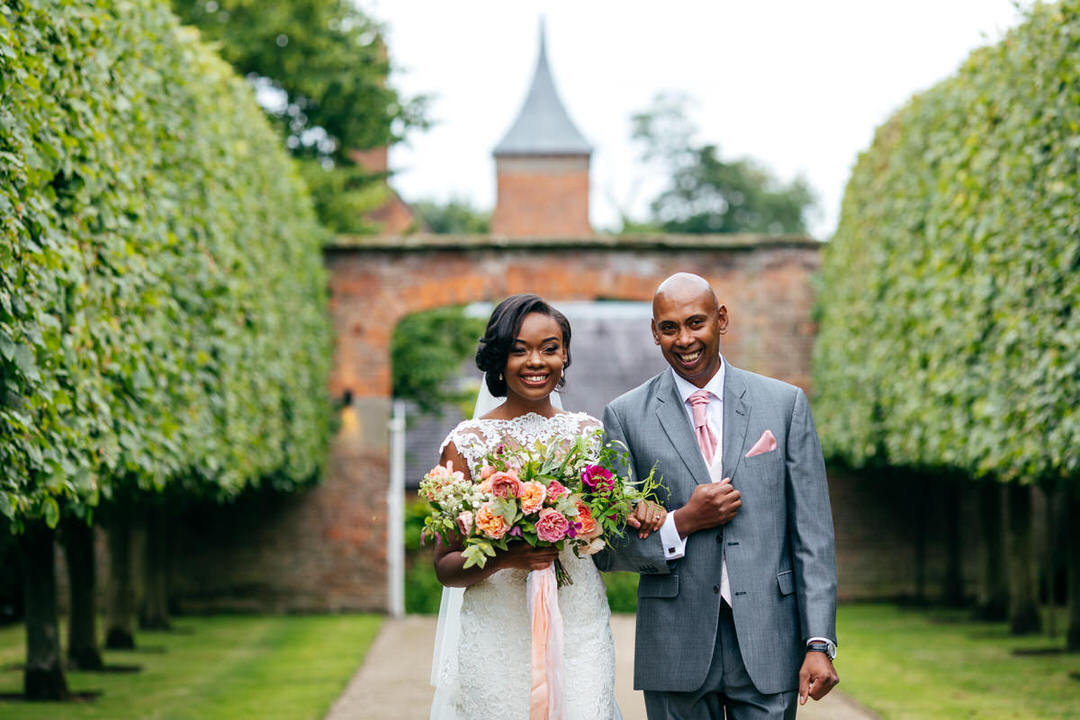 father-walks-bride-through-trees-combermere-abbey