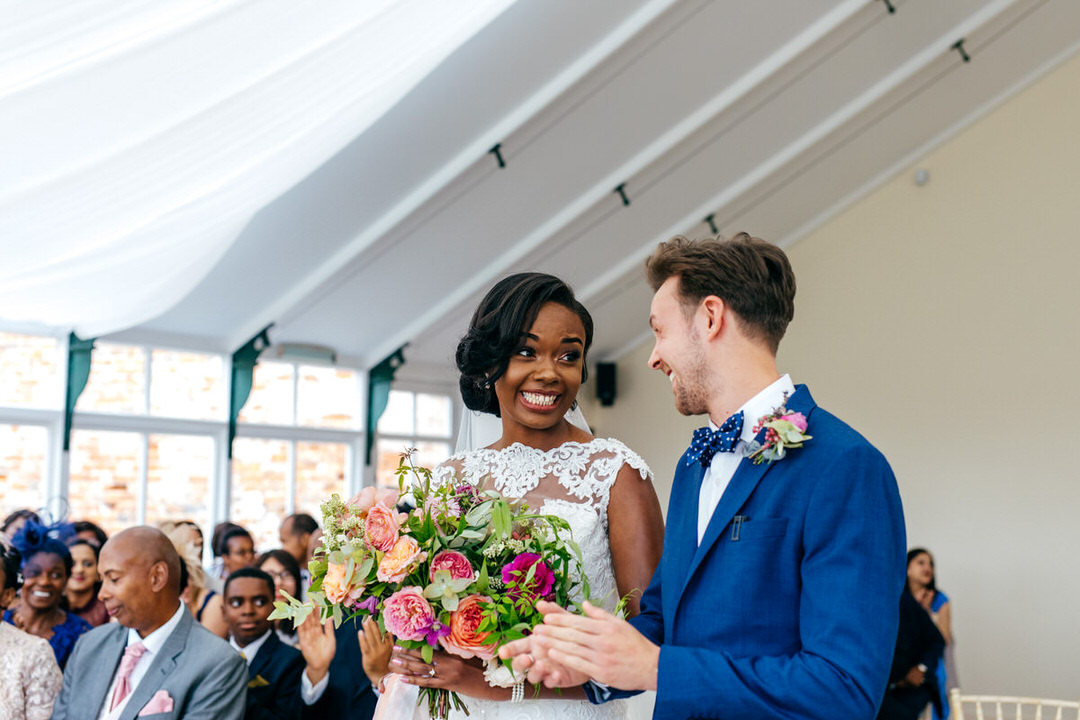 wedding-ceremony-combermere-abbey-smiling-bride