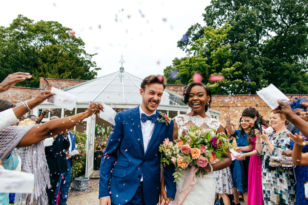 confetti-tunnel-laughing-bride-liberty-lane-flowers