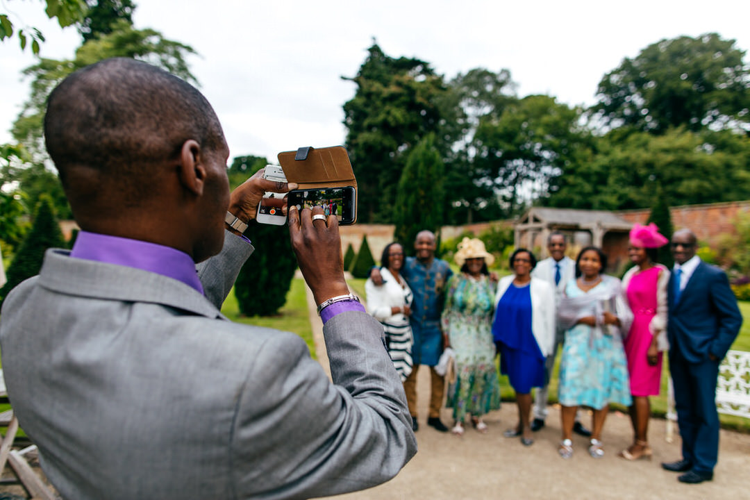 guest-at-combermere-abbey-takes-group-shot-on-iphone