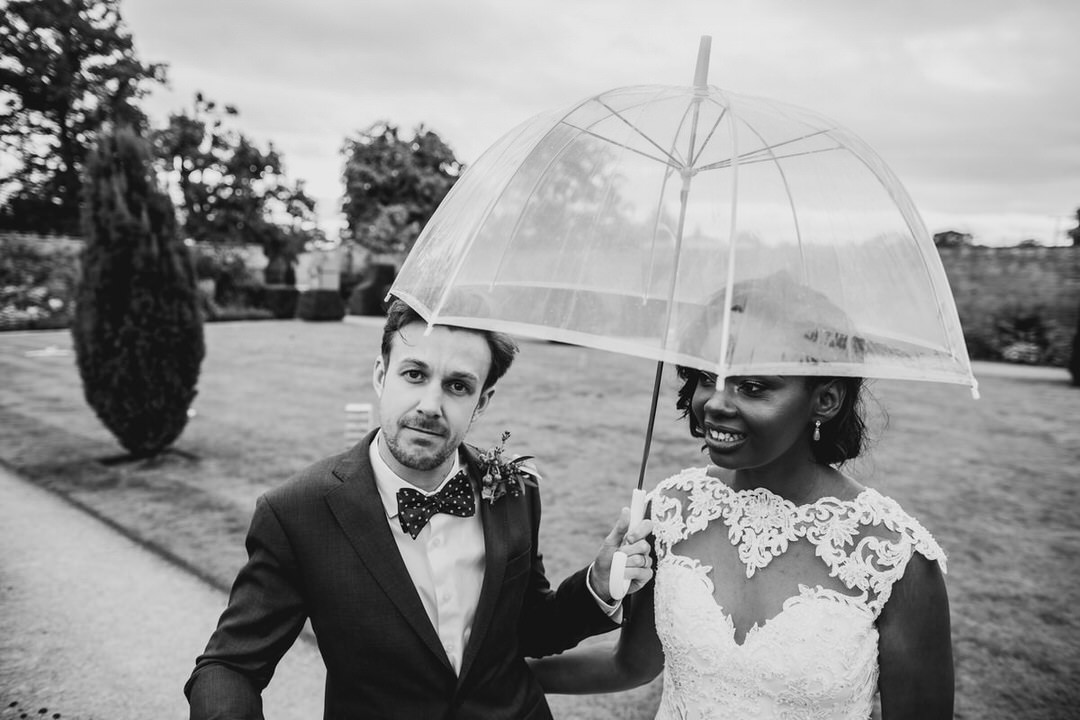 wedding-fun-portrait-black-and-white-couple-under-umbrella