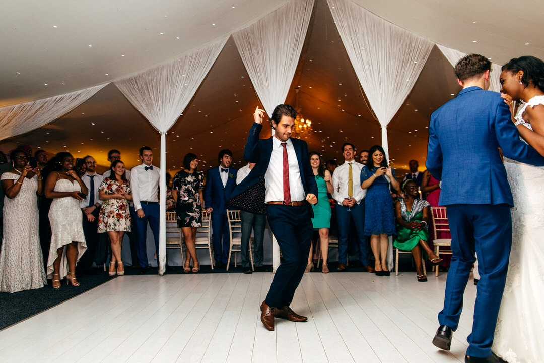 wedding-guest-does-funny-dance-combermere-abbey