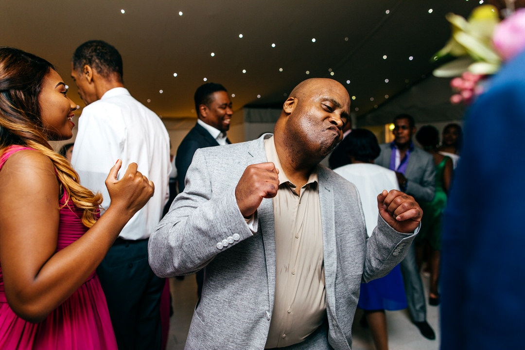 funny-wedding-guests-dancing-combermere-abbey-creative-wedding-photogrpahy
