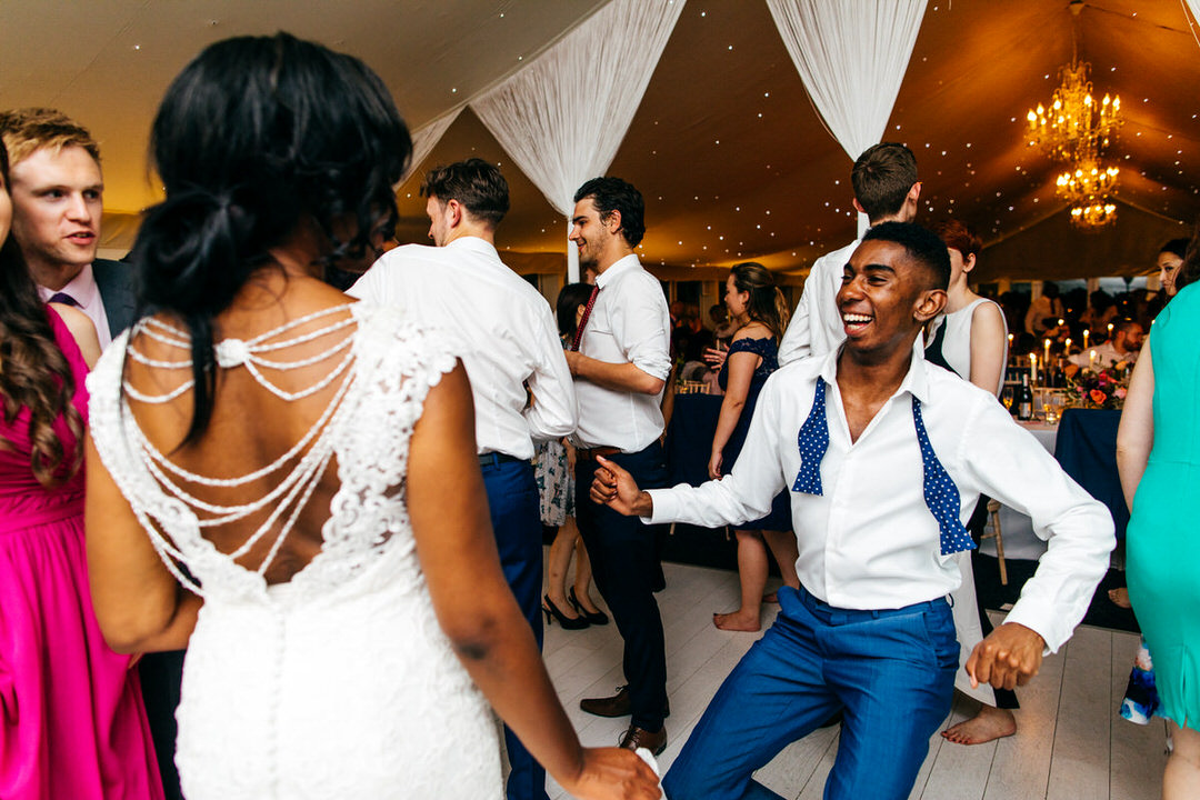trendy-guest-blue-polkadot-bow-tie-dances-with-bride