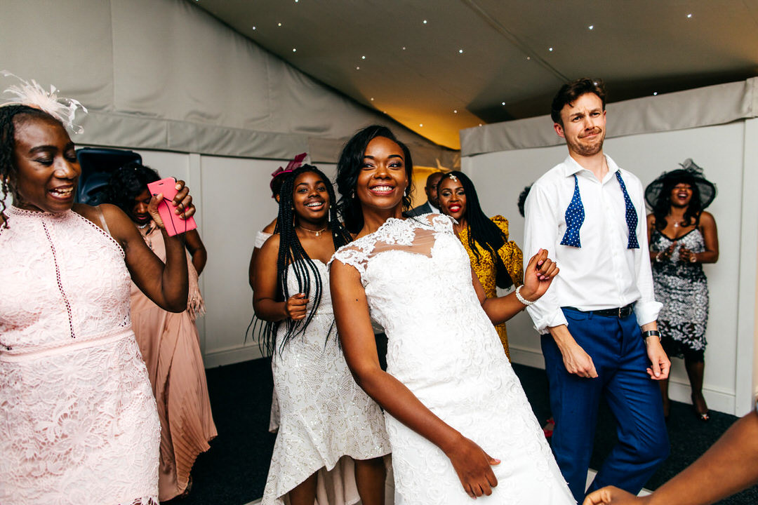 beautiful-bride-in-lace-dress-dances-with-guests-for-her-and-for-him