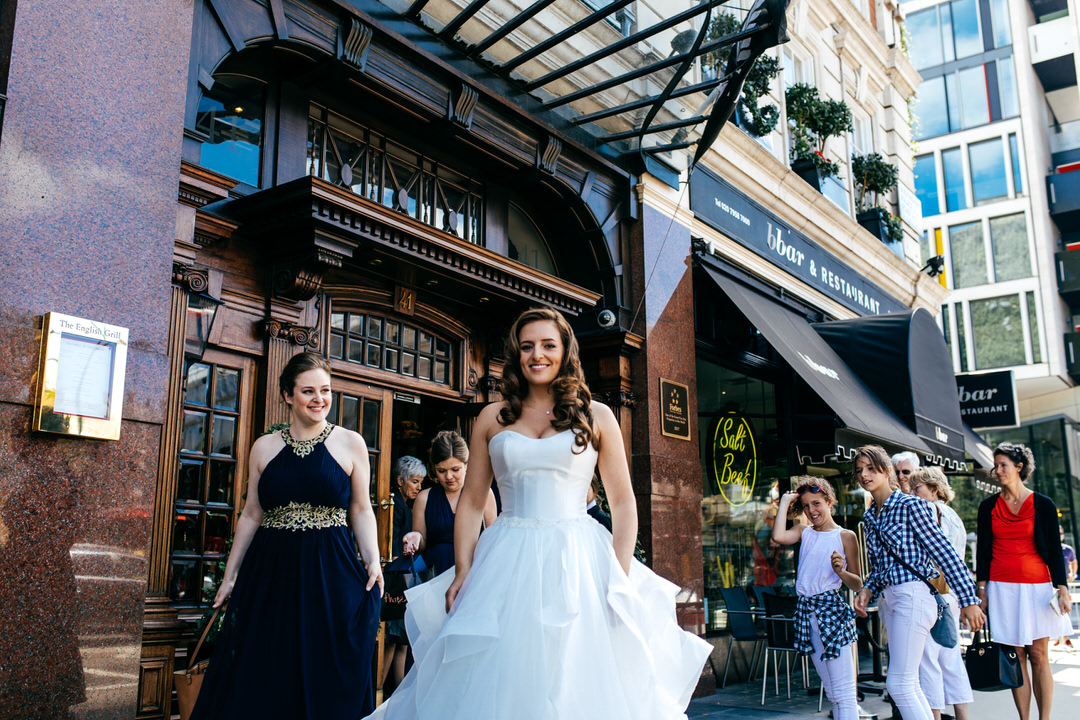 bride-walking-down-london-street-documentary-shot-creative-wedding-photography