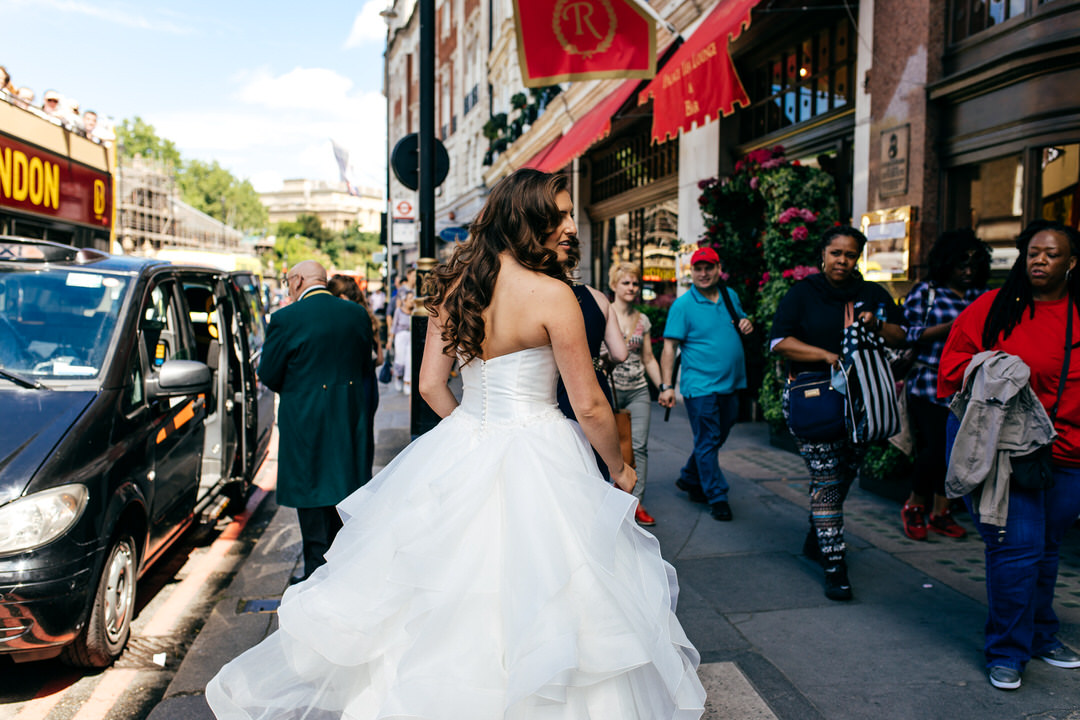 bride-getting-in-cab-full-tulle-skirt-wedding-gown-devonshire-terrace-wedding
