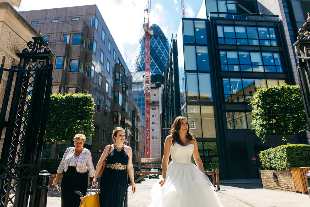 bride-approaches-devonshire-terrace-with-gherkin-behind-london-wedding-photography