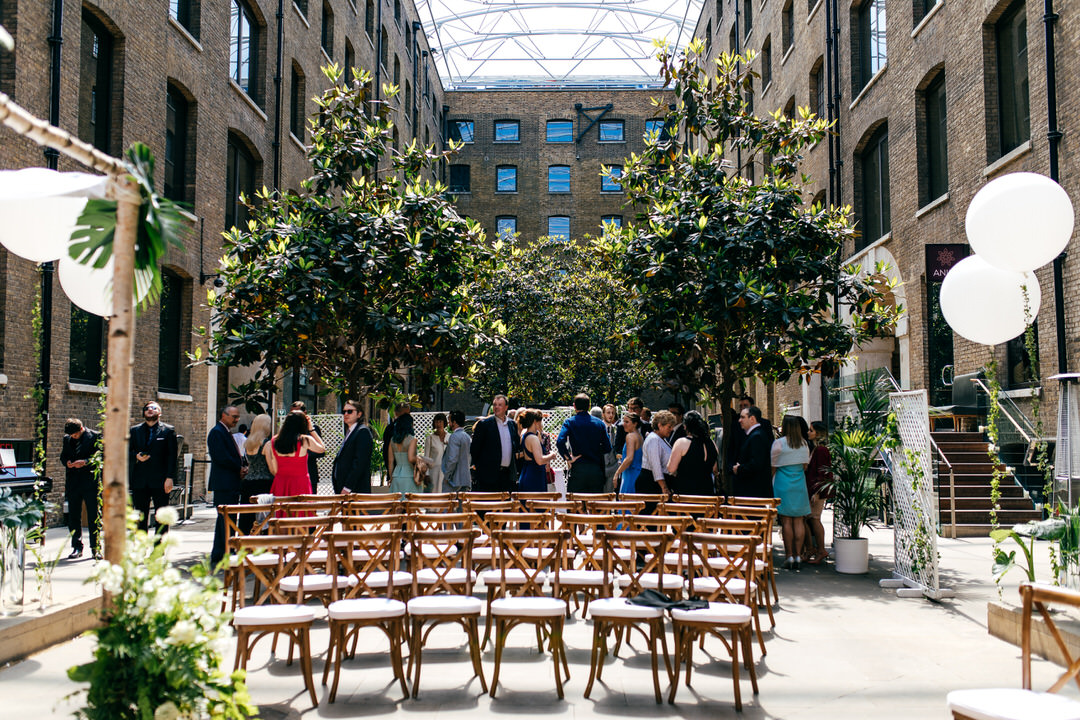 guests-are-seated-devonshire-terrace-london-wedding-jordanna-marston-photography