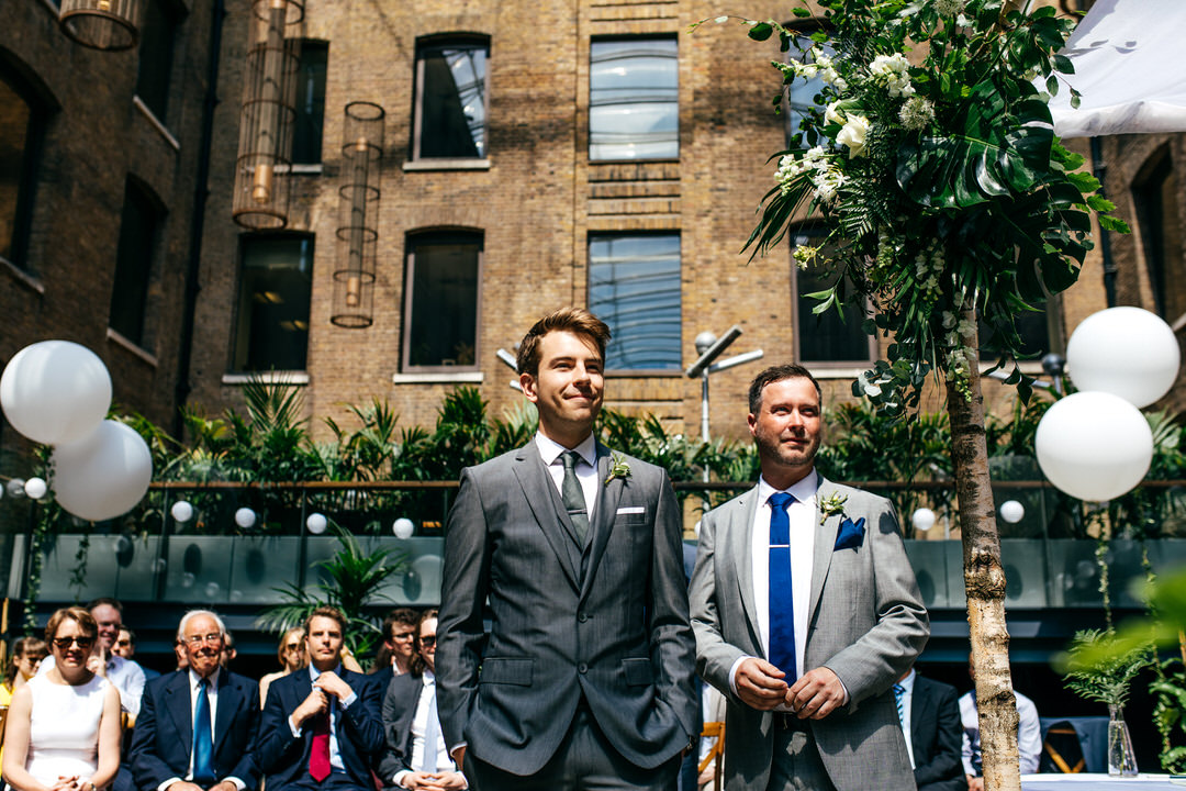 groom-standing-with-best-man-in-sun-at-devonshire-terrace