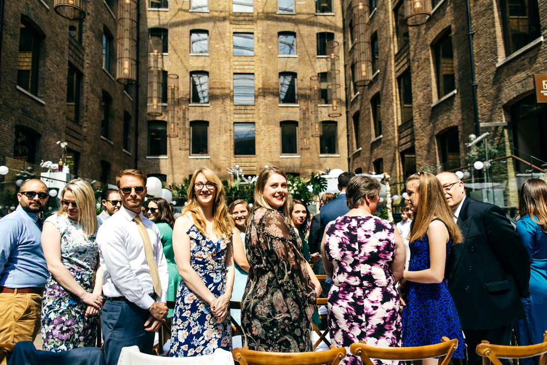 guests-welcome-bride-well-dressed-guests-london-wedding-photography