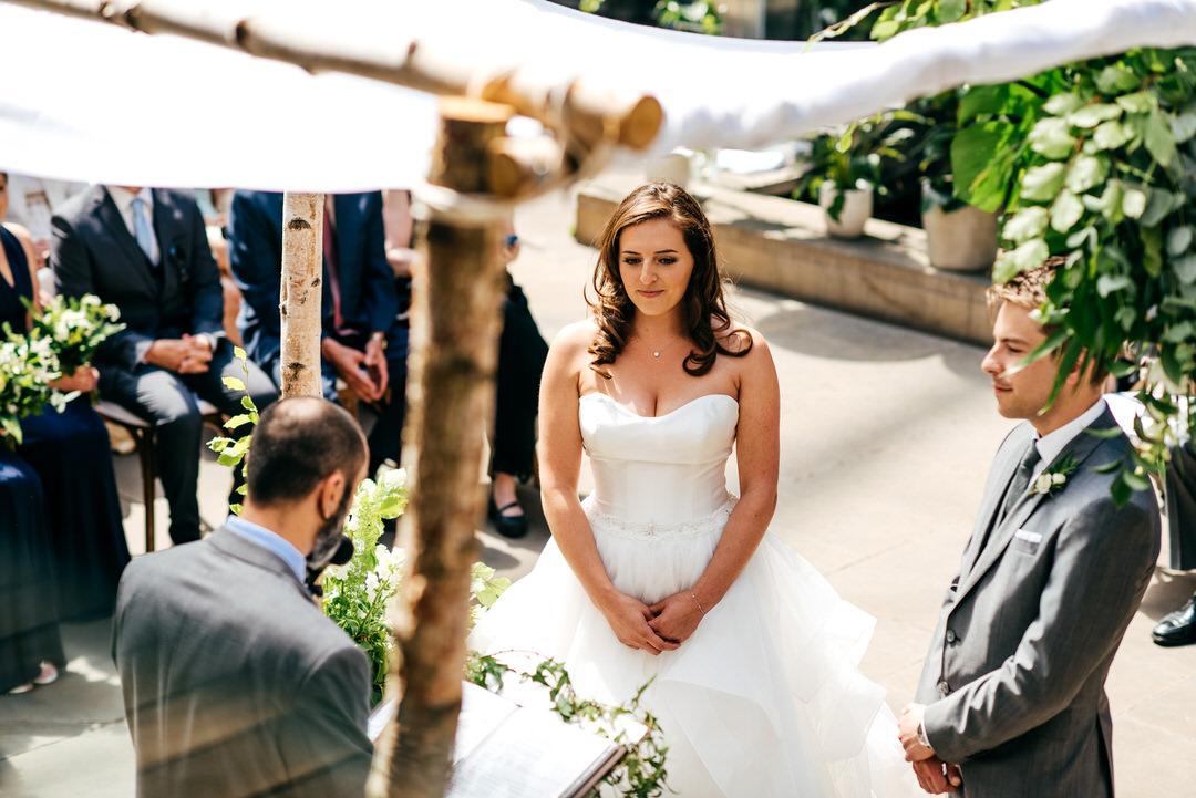 bride-stands-under-chuppah-jewish-wedding