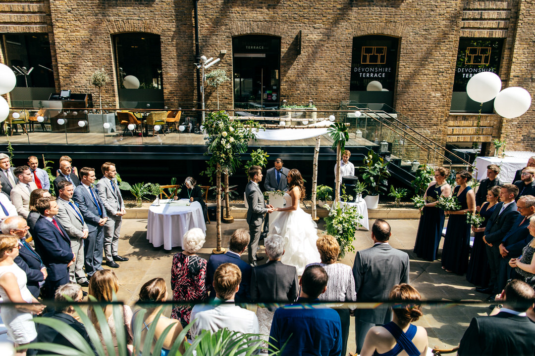 wedding-vows-surrounded-by-guests-devonshire-terrace-wedding