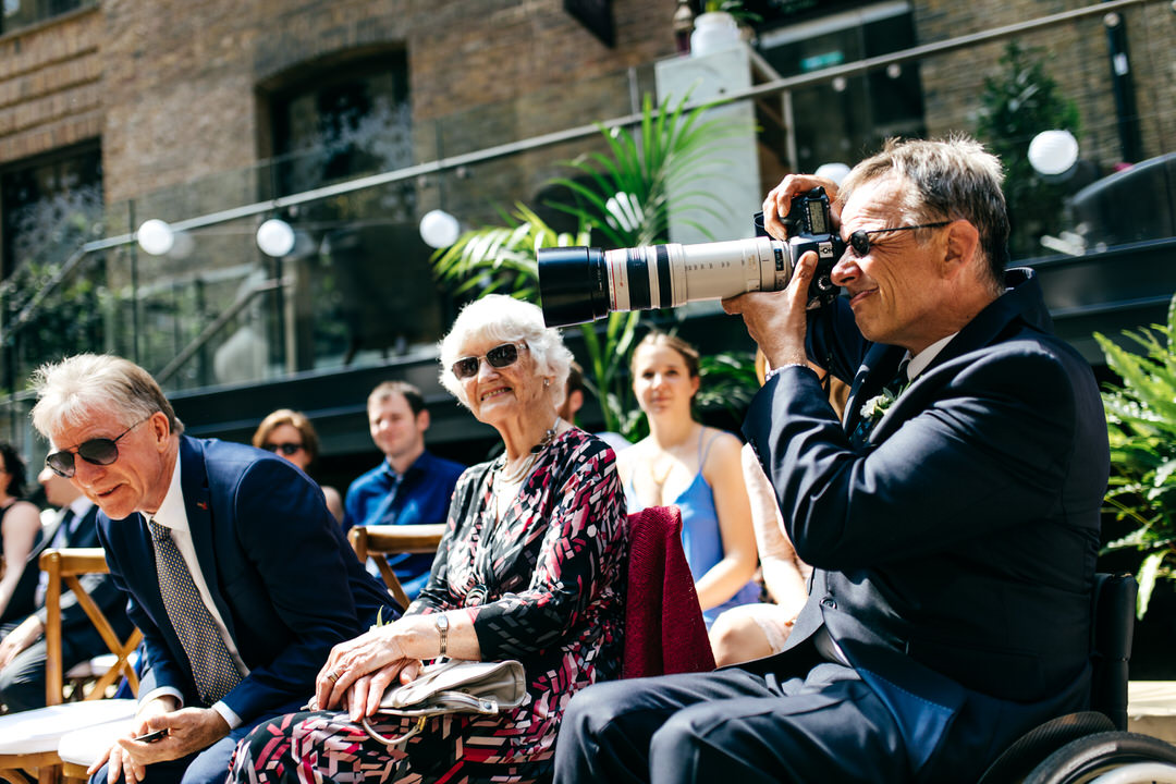 guest-taking-photos-london-wedding-photography