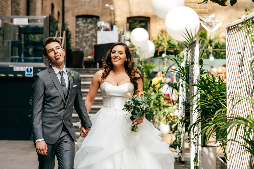 couple-walk-together-just-married-creative-wedding