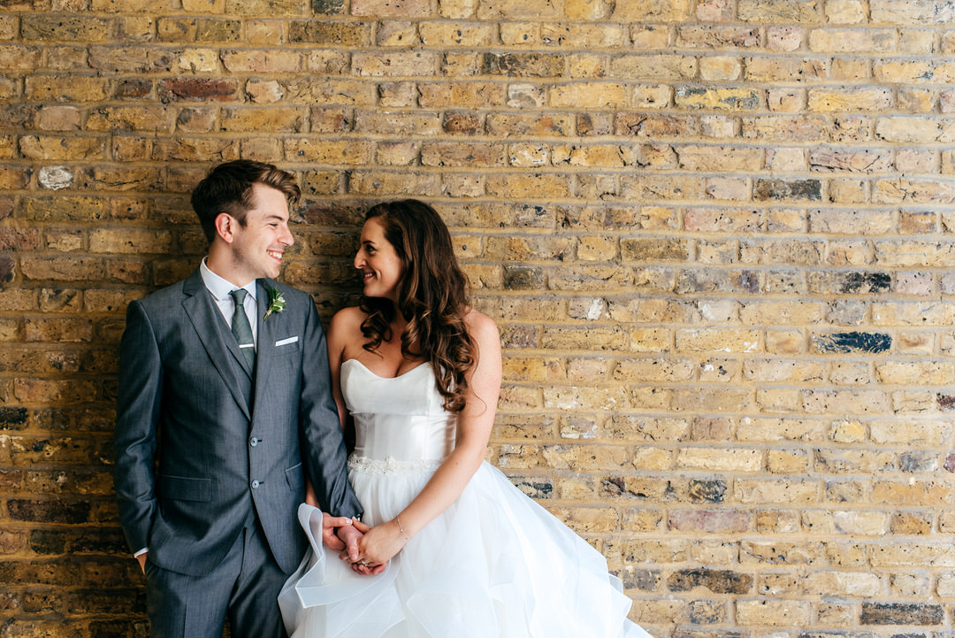 wedding-portraits-couple-laughing-together-urban-backdrop-london-wedding-photographer