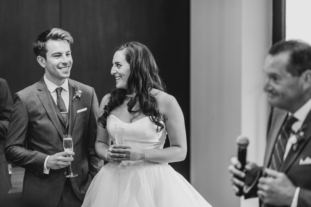 monochrome-wedding-couple-listen-to-speeches-jewish-wedding